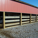 One way to keep your feed barn and handling areas from being constantly torn up or pushed against is to put one or more rows of guardrail along the sides wherever the cattle travel – this is a one time fix.