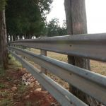 Put it up once, and it will last you for generations. Here's a father and son strolling down the area they have wrapped up with guardrail panel. Just how many of these generations will this fence see?