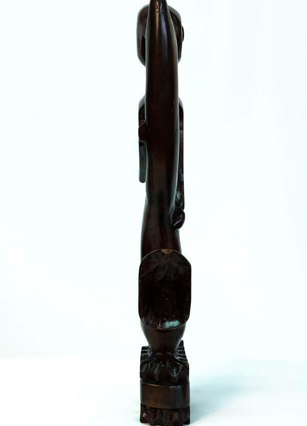 wood figurine, abstract horn player, front