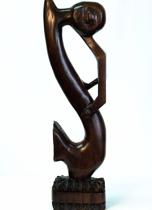 wood figurine, abstract horn player, left