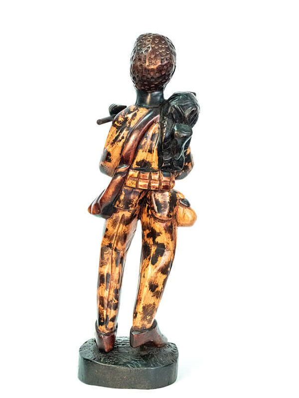 wood figurine, african hunter carrying spear, back