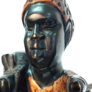 wood figurine, african hunter carrying spear, closeup