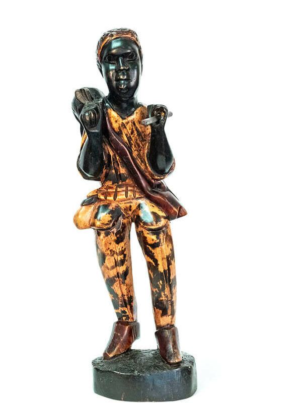 wood figurine, african hunter carrying spear, front