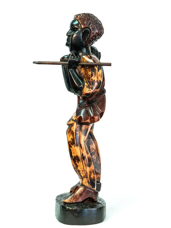 wood figurine, african hunter carrying spear, left