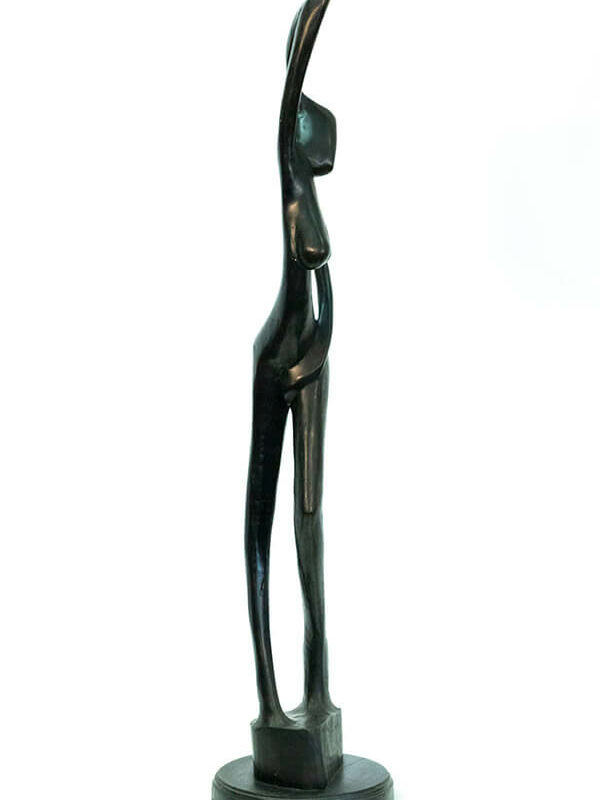 wood carving, stylistic rendering of woman posing, right