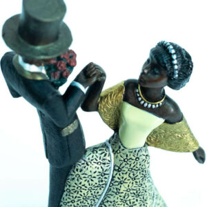 wedding couple figurine, groom with flowers, bride curtsy, closeup