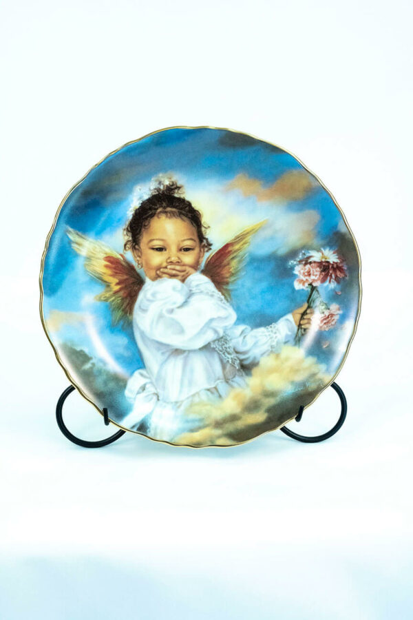 collectible plate with giggling cupid, on plate stand front