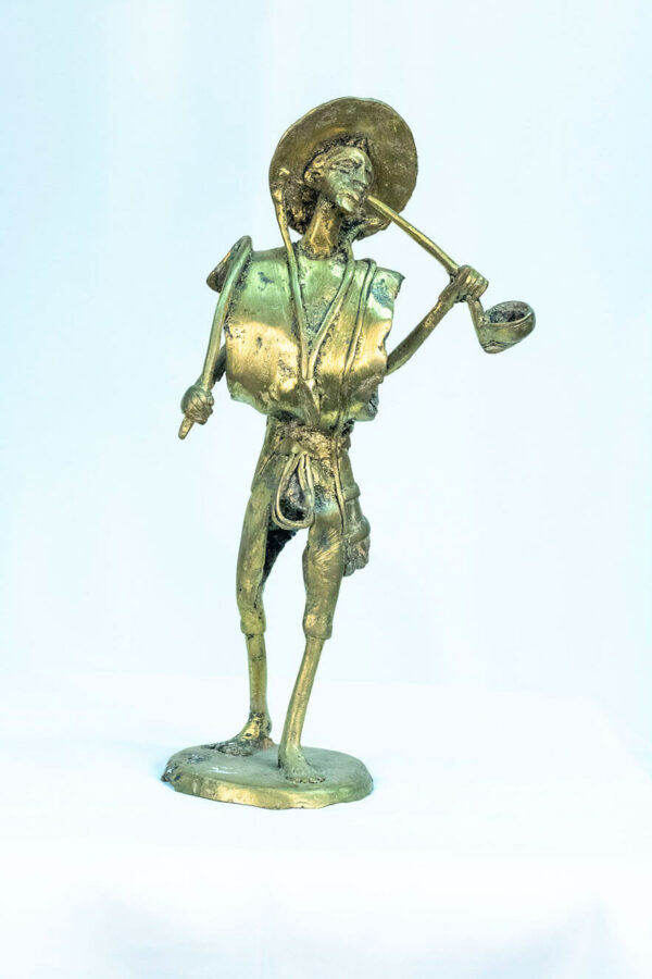 figurine, brass man with pipe, front