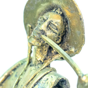 figurine, brass man with pipe, closeup