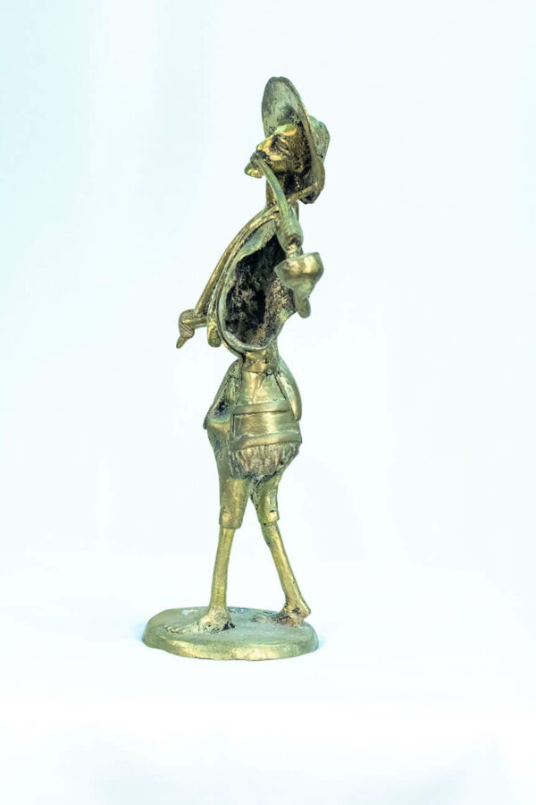 figurine, brass man with pipe, left