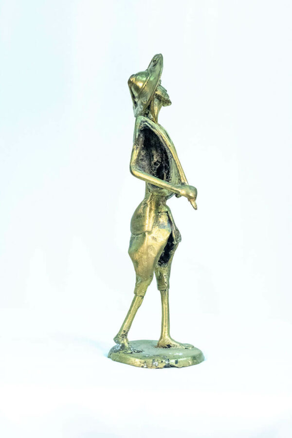 figurine, brass man with pipe, right