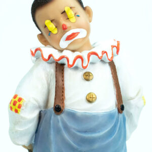 clown figurine, child clown in baggy blue pants, closeup