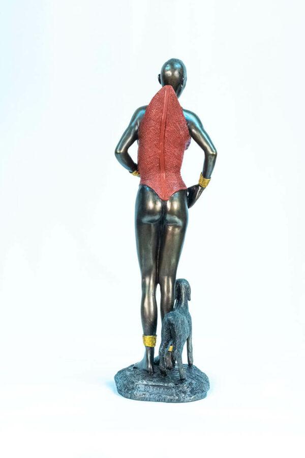 figurine, dinka lady with lamb, back