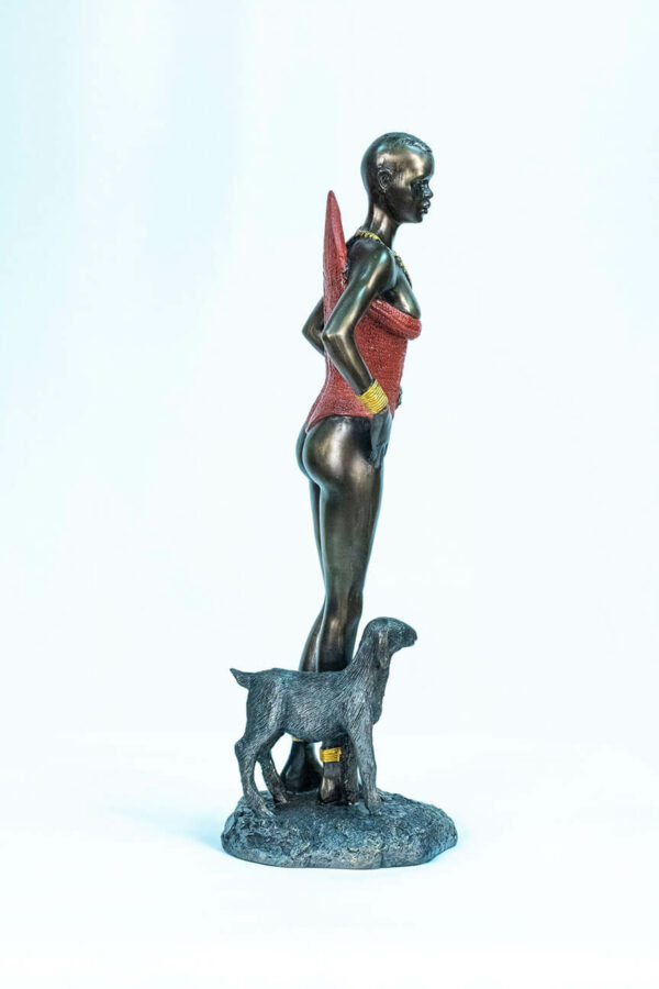 figurine, dinka lady with lamb, right