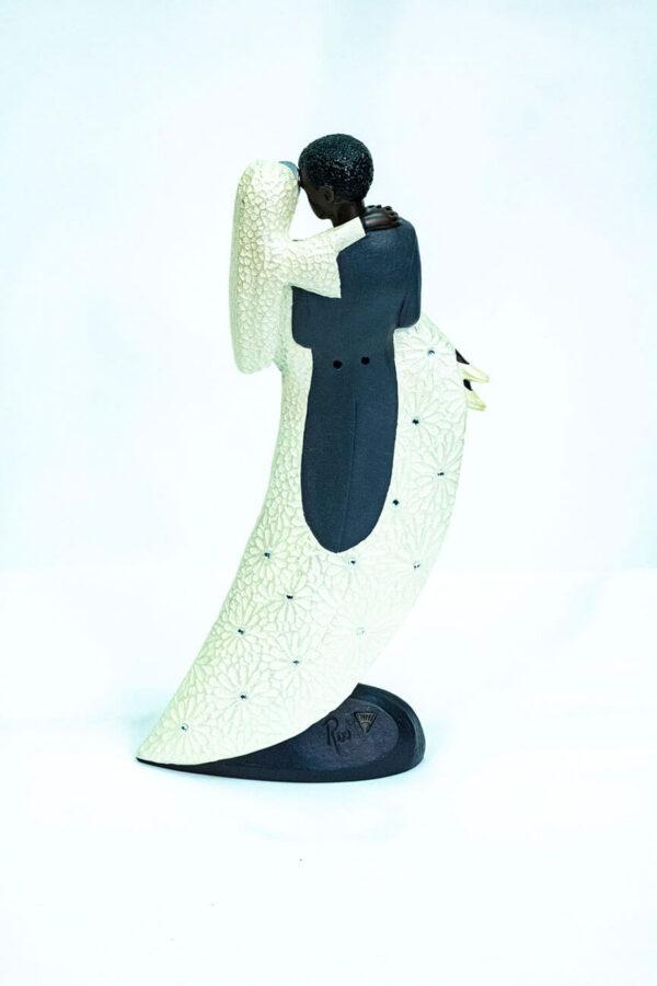 wedding couple figurine, groom holding bride, back
