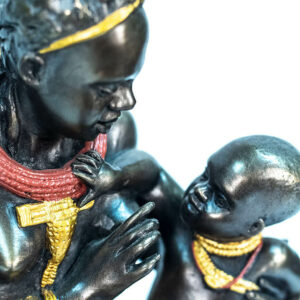 figurine, himba lady feeding her baby, closeup