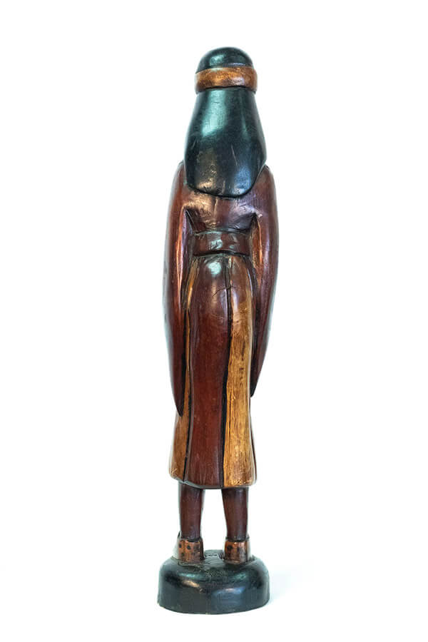wood carving of man with beard holding gourd offering, back