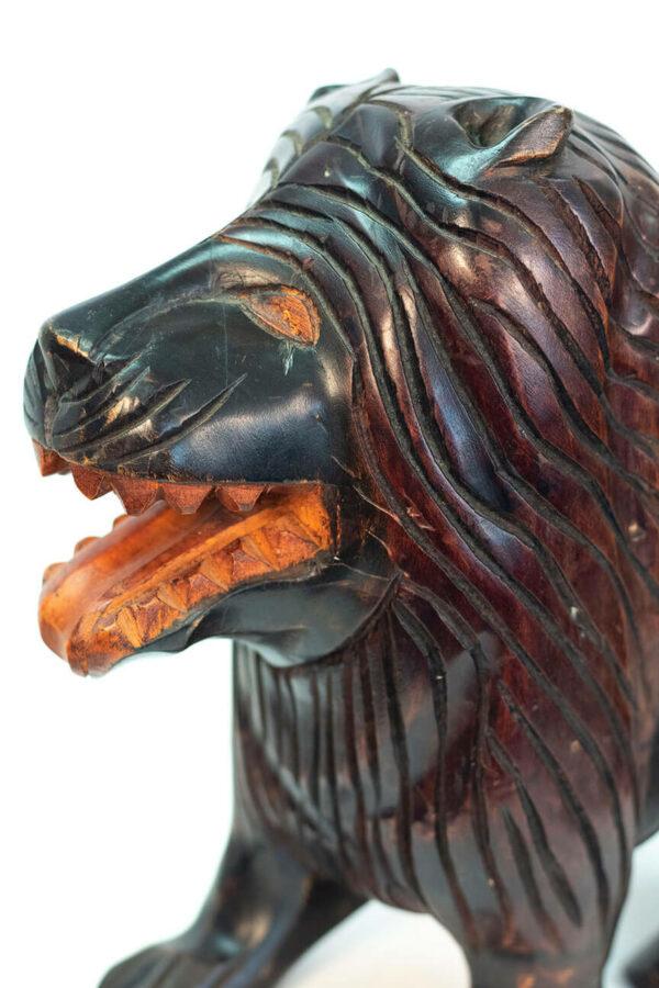 wood carving of lion, closeup