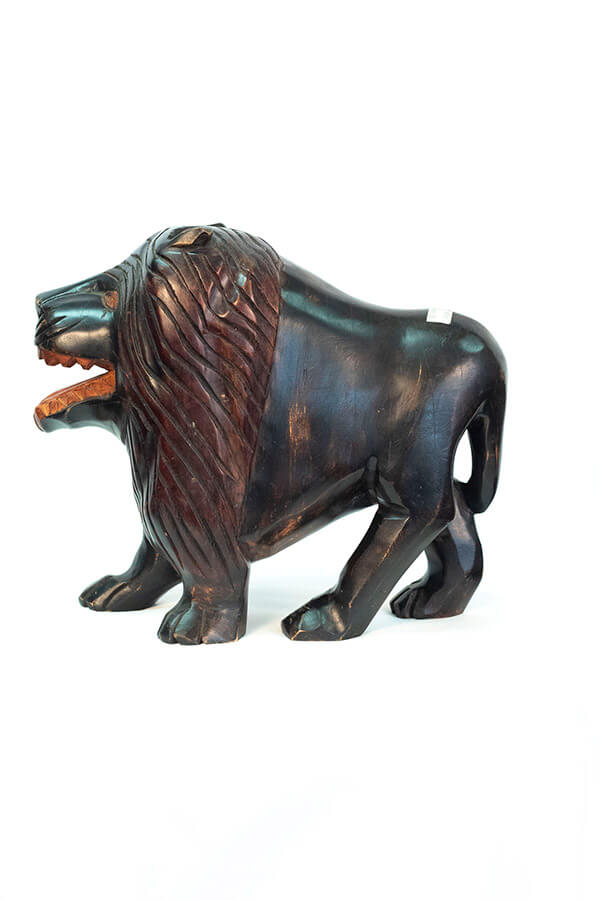 wood carving of lion, left