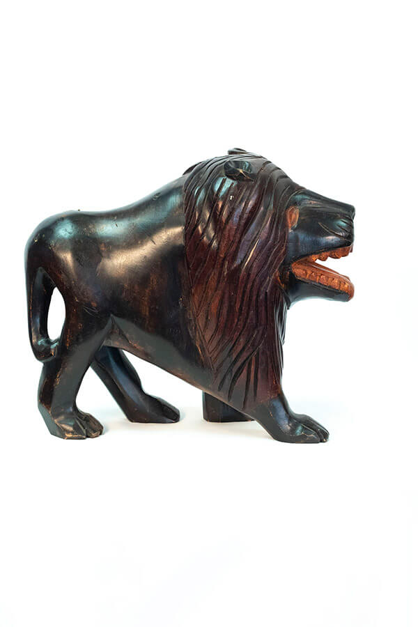 wood carving of lion, right