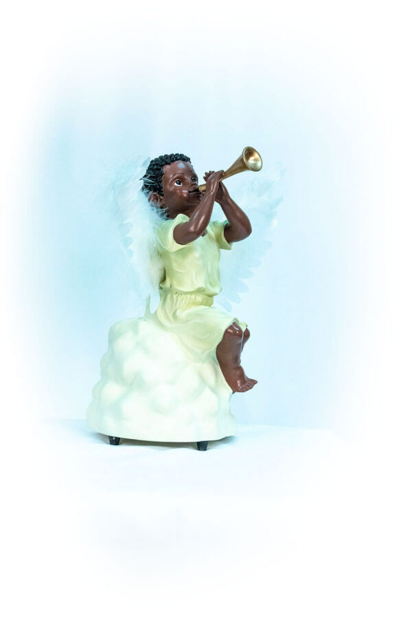 figurine, angel sitting on rock blowing horn, right