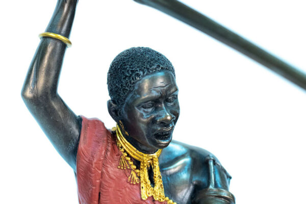 figurine, meru warrior throwing spear, closeup