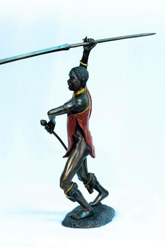 figurine, meru warrior throwing spear, left
