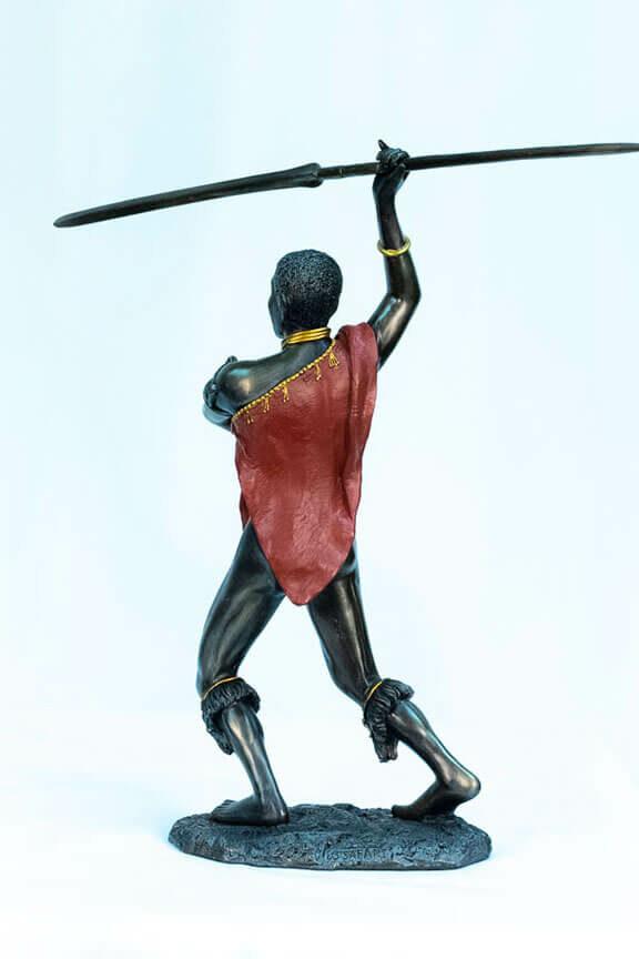 figurine, meru warrior throwing spear, back