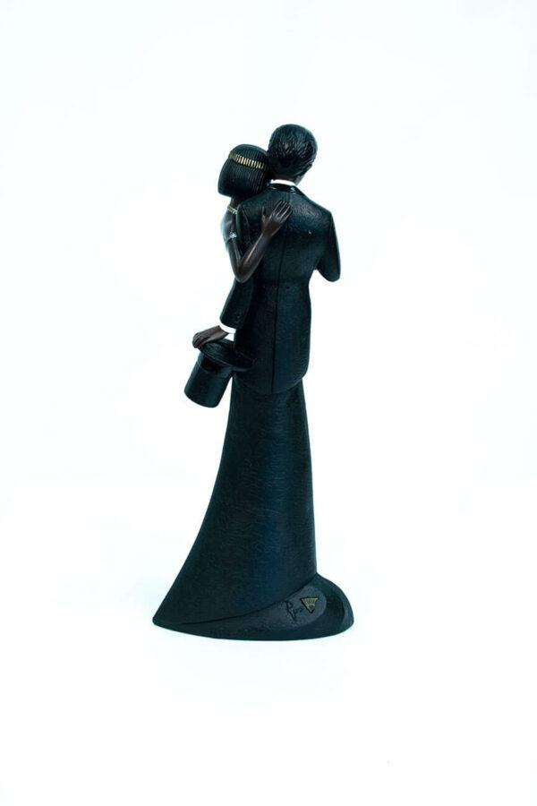 wedding couple figurine, bride and groom admire ring, back