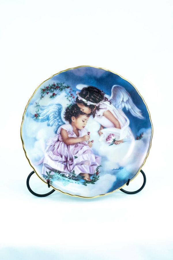 collectible plate with two cupids, on plate stand front