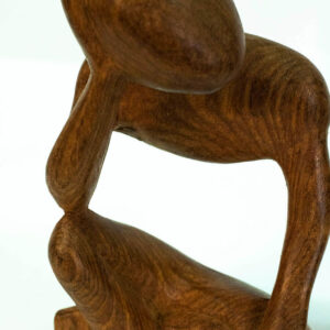 wood carving, stylistic rendering of small thinker, closeup