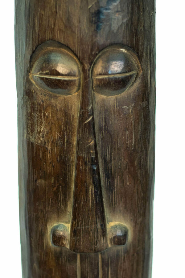 wood carving, african standing mask, closeup