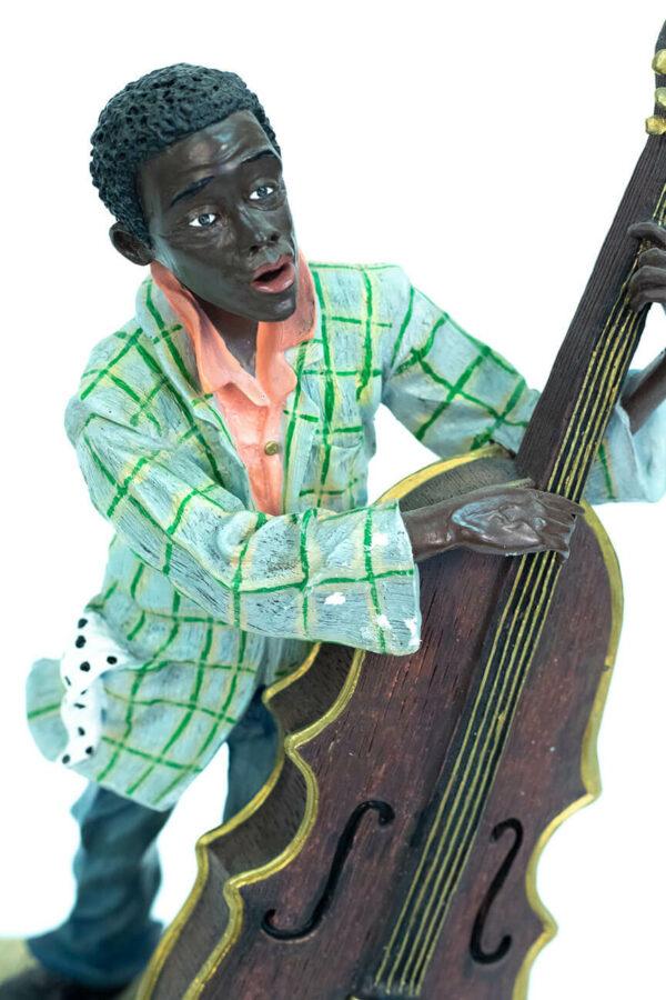 jazzman figurine, playing upright bass, closeup