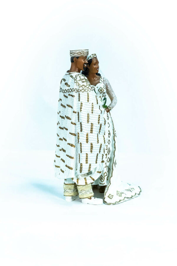 wedding couple figurine, in royal gold african attire, right