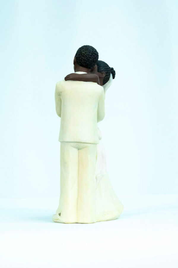wedding couple figurine, dancing bride and groom in white, left