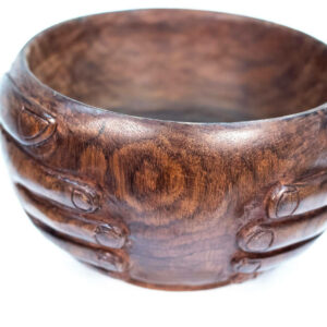 wooden bowl with hands carved on the sides, closeup