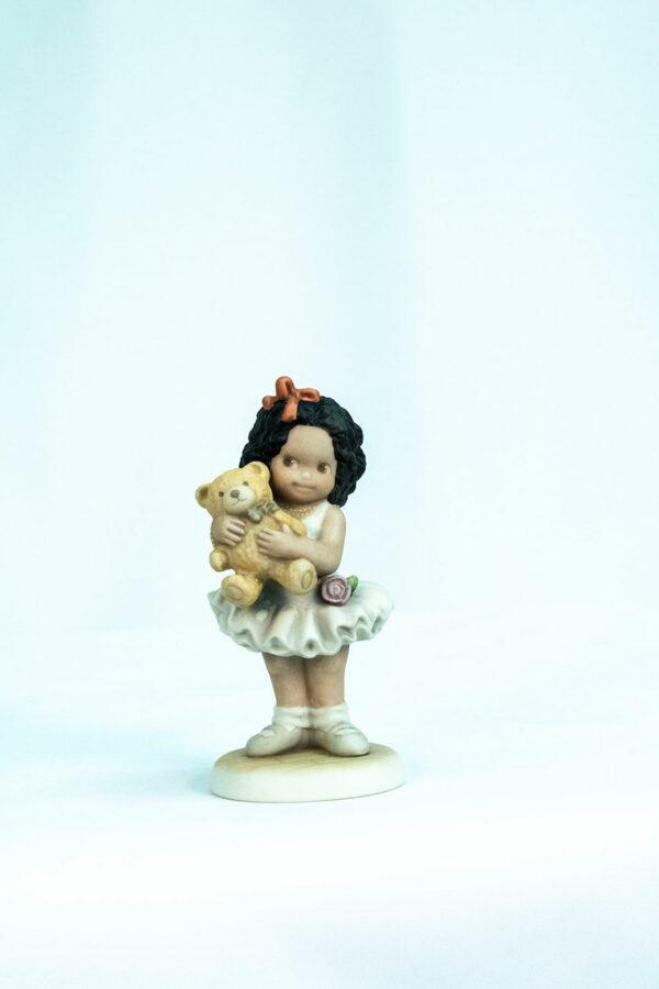 figurine, little girl holding teddy bear, front