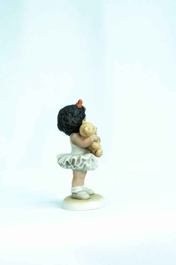 figurine, little girl holding teddy bear, right