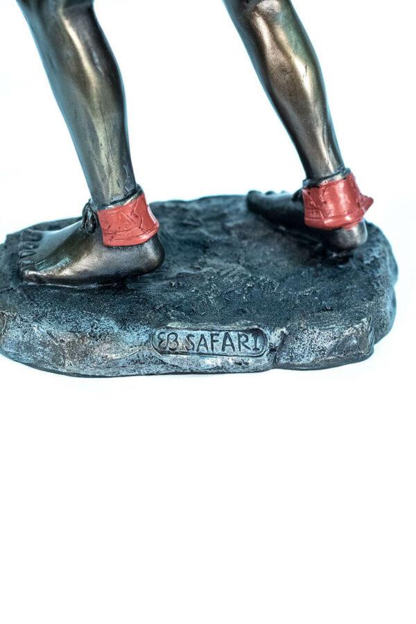 figurine, zulu male dancer, base detail