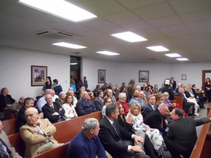 Seats in WNEU's courtroom gallery were full (WMassP&I)