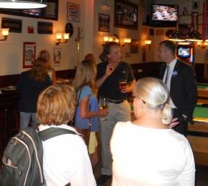 Michael Nichols, far right, talks to voters at Cornwalls (WMassP&I)