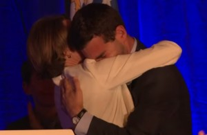 Mike Firestone and Healey embrace on primary night after Healey called him to the stage. (via Youtube/Healey campaign)