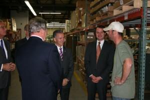 Rep Brian Ashe, center and Sen. Eric Lesser meet a longtime Excel employee. (Caroline Lee on behalf of Excel)