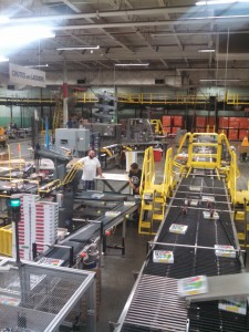 The factory floor of Cartamundi's plant, making Hasbro/Milton Bradley games.