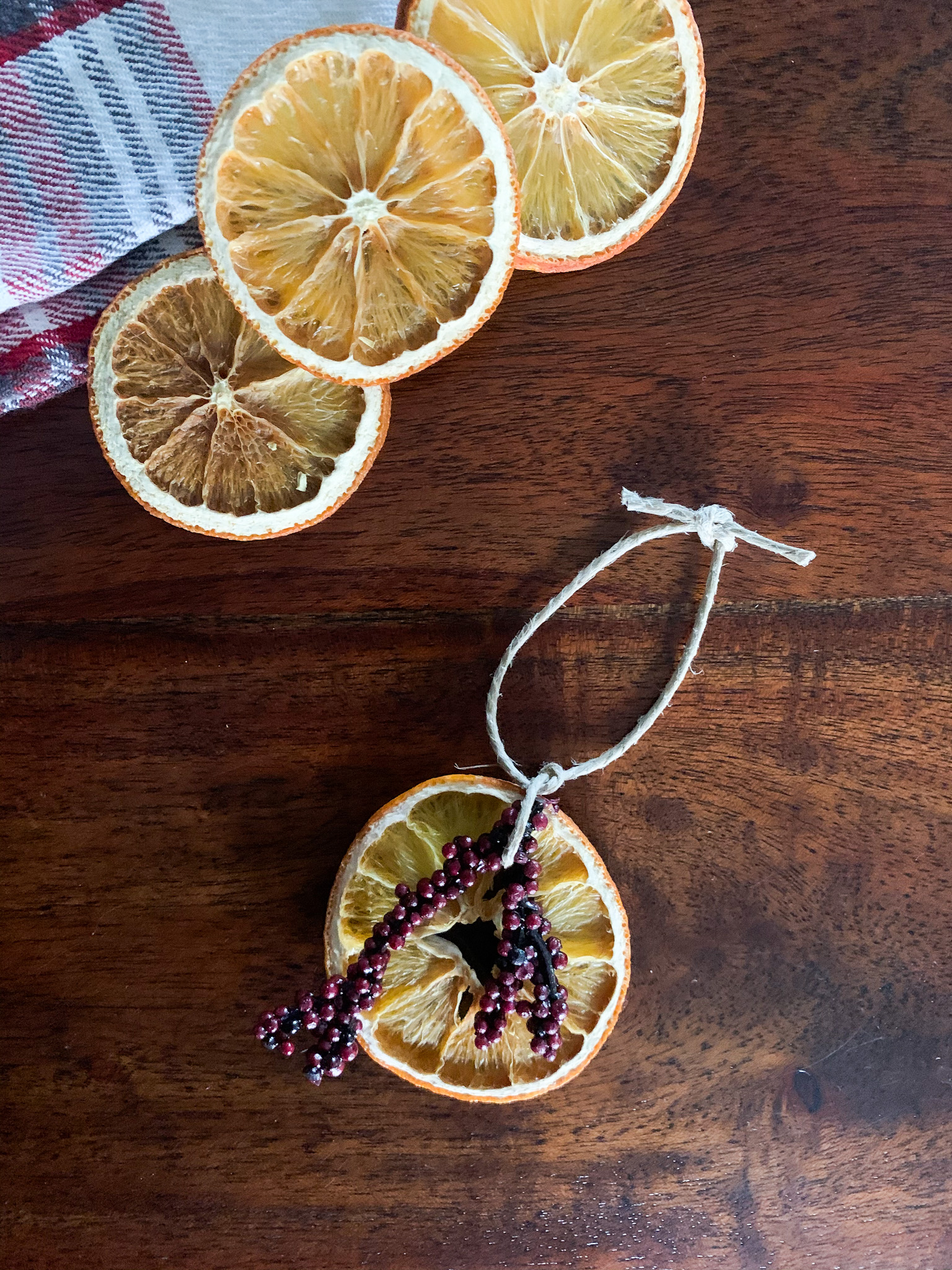 handmade dried orange ornament with floral and twine