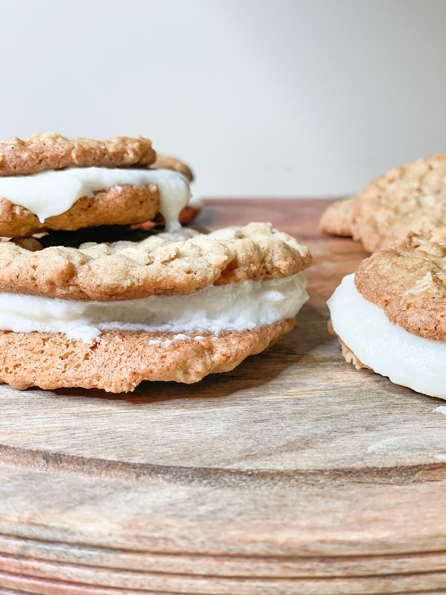 oatmeal creme pies on a wooden stand