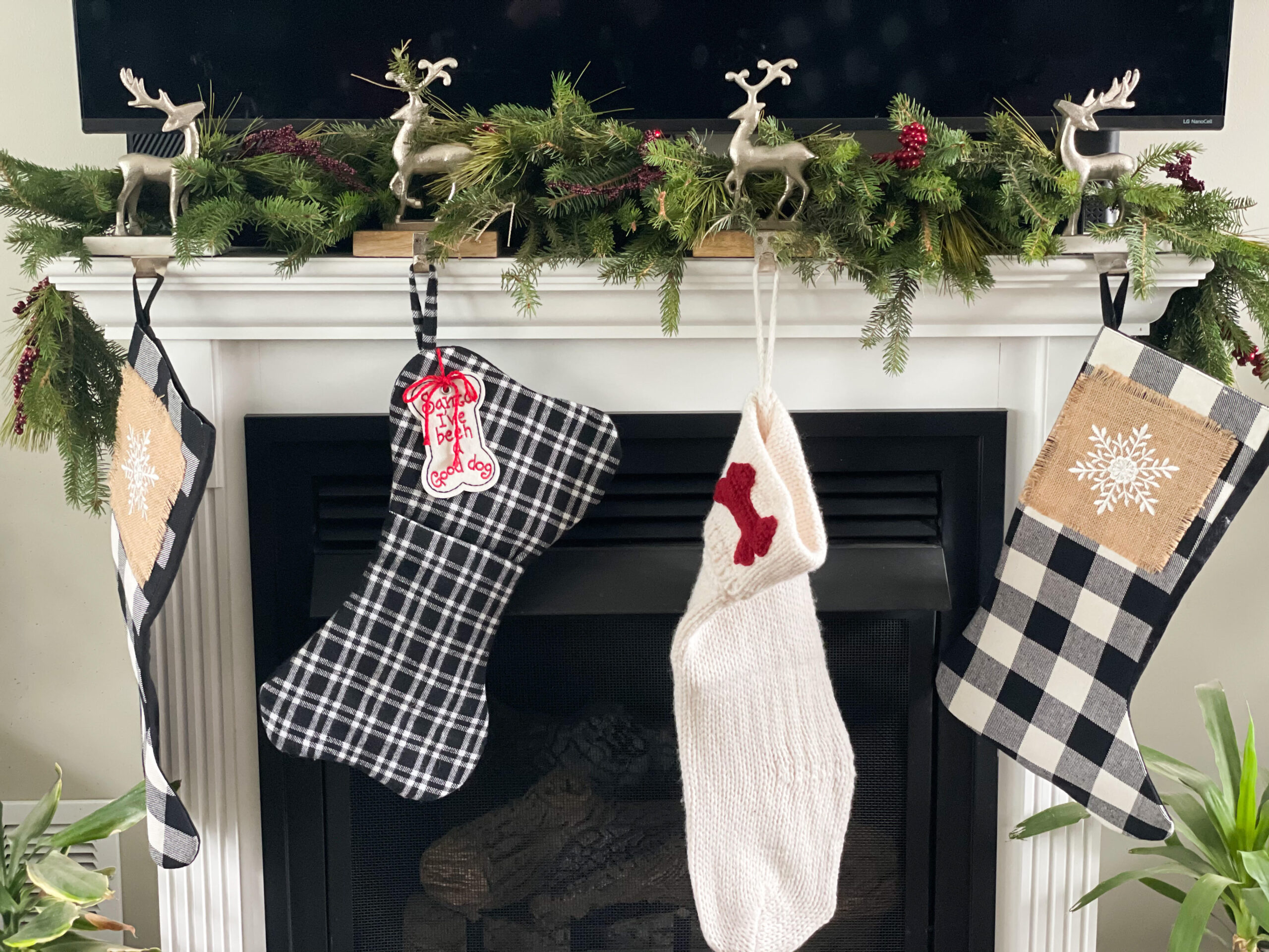real pine garland on the mantle with stocking hanging