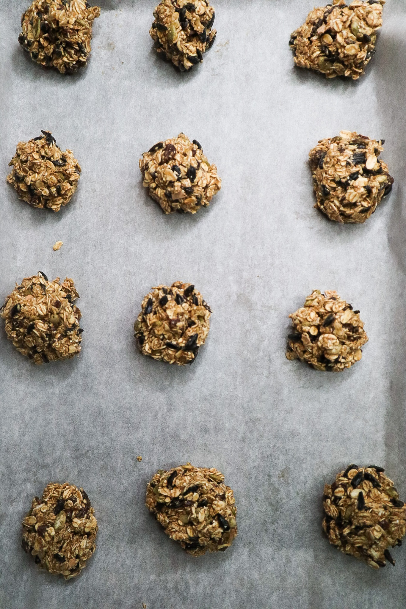 chicken treats in balls on a cookie sheet