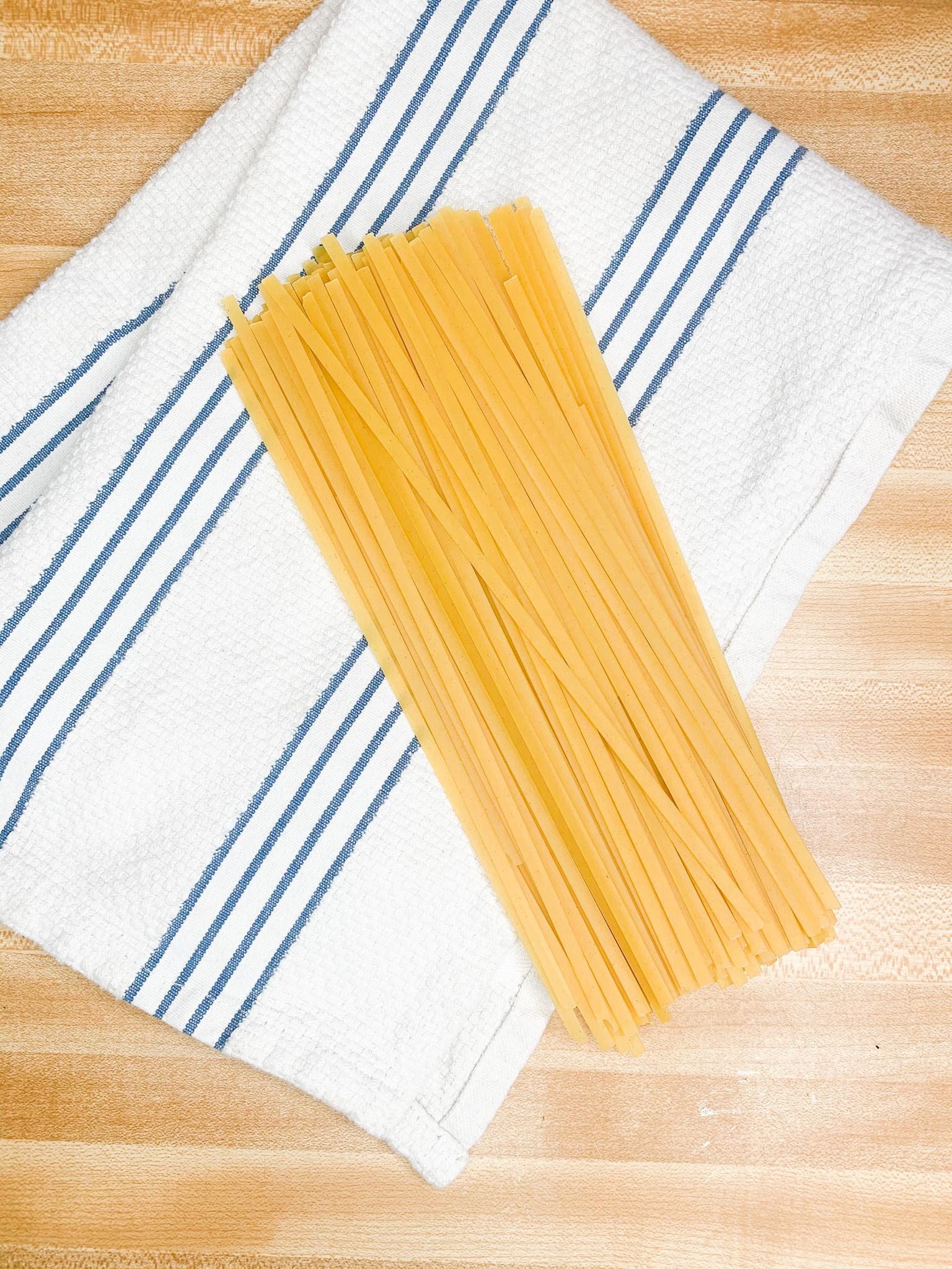 fettuccine noodles on a towel