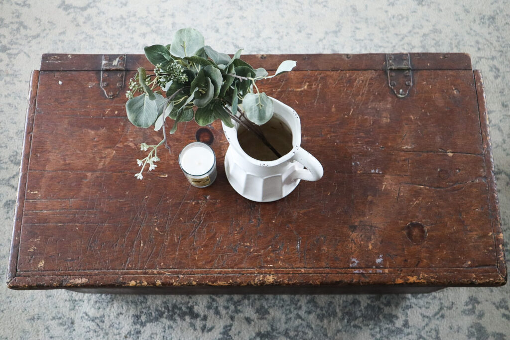 Antique chest in living room with vase